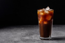 cold iced coffee on a  dark background,  summer drink