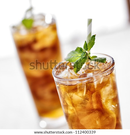 cold iced tea with mint garnish and lemon slices