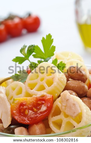 Cold Italian pasta, wheels with tuna, tomatoes, capers and olives, closeup - stock photo