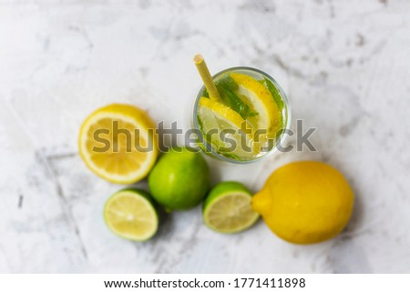 Cold lemonade with ice. Tasty lemonade with lemon, lime and mint.Cold lemonade with ice. Tasty lemonade with lemon, lime and mint. Summer refreshing drink. Top view