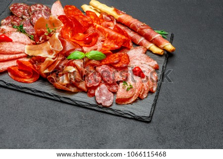 Cold meat plate with salami and chorizo sausage and parma