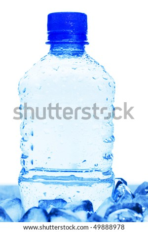 cold mineral water bottle with ice cubes