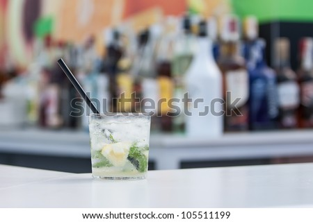 cold mojito cocktail with ice and fresh mint