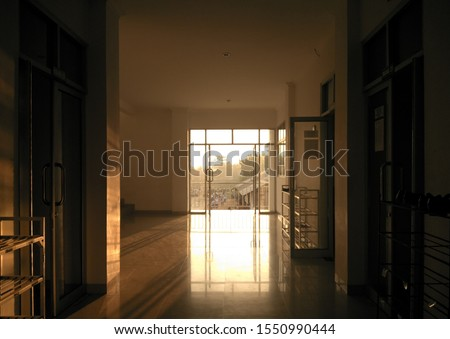 Cold passageway filled with sunlight. #1550990444