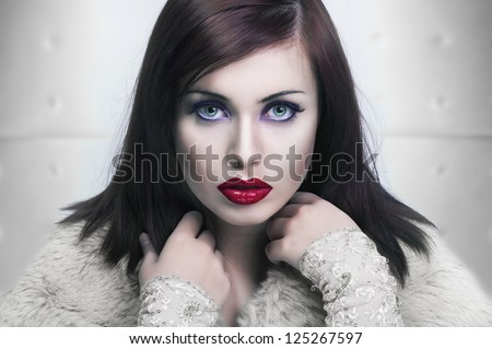 Cold portrait of a young lady with red lips