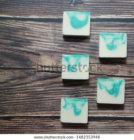 cold process handmade soap. green and white soap.