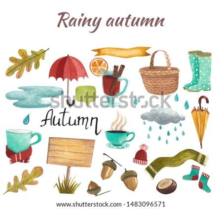 cold rain rainy autumn set, warm drinks, warm clothes, umbrellas and rubber boots