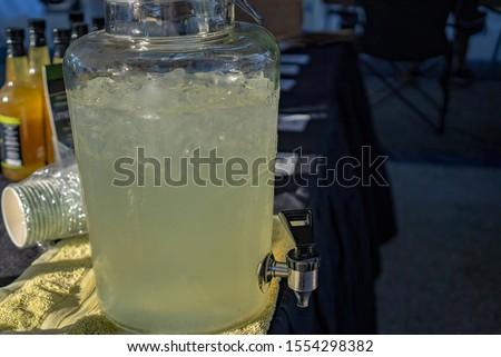 Cold refreshing lemonade for sale at a market stall #1554298382