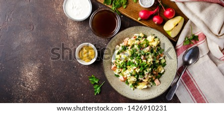Cold Russian Soup Okroshka with sausage, vegetables and kvass in bowl and raw ingredients on dark table. Top view. Space for text. Long wide banner. Long wide banner #1426910231