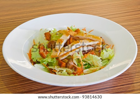 Cold salad with chicken meat served on a big white plate #93814630