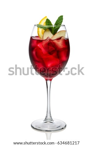 Cold sangria in a wine glass isolated on white. #634681217