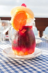 Cold sangria in the glass jug with condensate