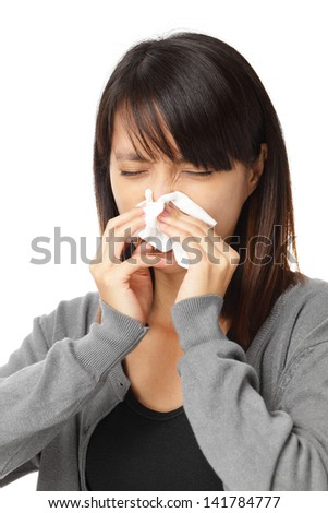 Cold sneezing asian woman