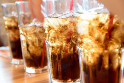 Cold soda iced drink in a glasses - Selective focus, shallow DOF