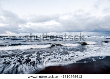 Cold stormy waves and clouds over the North sea, Netherlands #1310246413