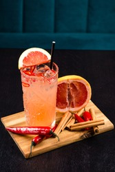 Cold summer spicy lemonade with grapefruit and chili pepper, colorful fruity cocktails with fruits