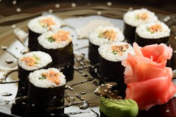cold sushi on black dish and white background