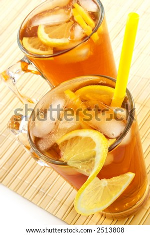 Cold tea with cubes of an ice and a lemon-is fine satisfies thirst in hot weather