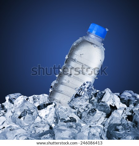 Cold Water Bottle On Ice Cubes #246086413