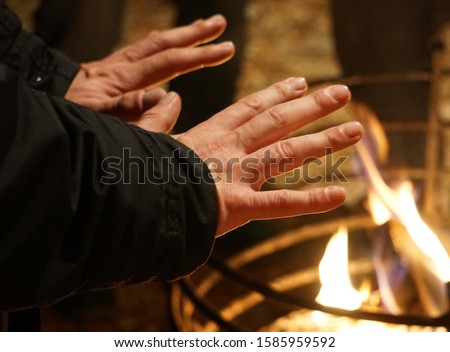 Cold Weather. Fire Flame And Hands Warm. Christmas Market, Germany.