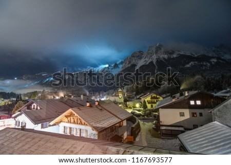 Cold winter snowy night in Germay ski town of Garmisch-Partenkirchen #1167693577