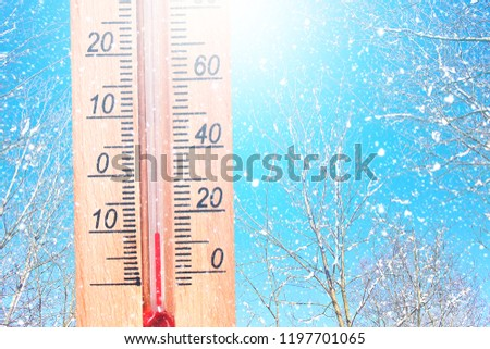 Cold winter weather - 10 degrees Celsius. Thermometer in winter frosty weather in the snow shows low temperatures - minus ten. Low temperatures in degrees Celsius.