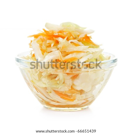 Coleslaw in glass bowl on white background