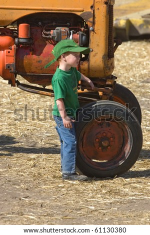 COLFAX, WASHINGTON-SEPT 6:A young future farmer stand by a tractor during the Sept 6, 2010 threshing bee in Colfax, Washington.