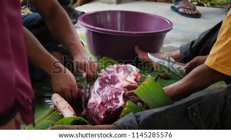 Collaboration and cutting meat sacrifices for the celebration of Eid Mubarak #1145285576