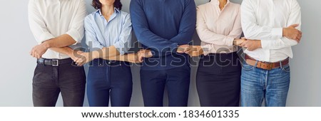 Collaboration, support, unity, solidarity concept. Team of workers holding hands ready to defend company interests and help each other. Business partners standing together. Banner, header, hero image