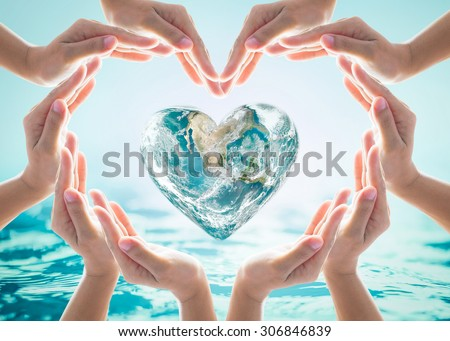 Collaborative human hand group heart shape around love green globe on blurred cyan turquoise blue wavy spa water background: Saving water CSR concept idea: Element of the image furnished by NASA