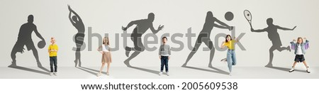 Collage. Dreams about big and famous future. Conceptual image with little boys and girls and shadows of professional sportsmen on gray background. Childhood, dreams, imagination, education concept. Foto stock ©