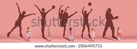 Collage. Dreams about big and famous future. Conceptual image with little girls and shadows of fit professional sportsmen on light pink, coral background. Dreams, imagination, education concept.