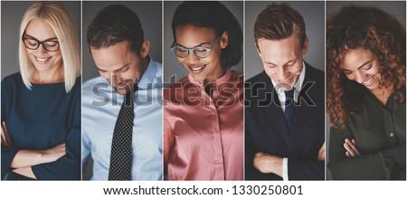Collage of a diverse group of smiling businessmen and businesswomen looking down while standing against a gray background #1330250801