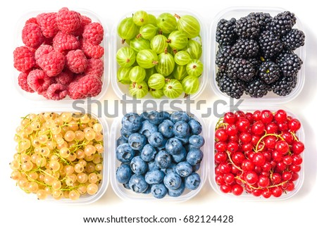 Collage of different fruits and berries isolated on white. Blueberries, cherries, blackberries, grapes, strawberries, currants. Collection of fruits and berries in a bowl. Top view. #682124428