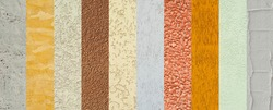 Collage of different types of plaster. Decorative walls are different in color and shape. Samples of decorative walls.