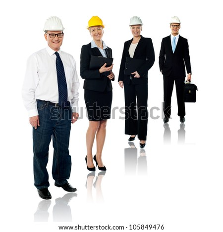 Collage of experienced architects team wearing safety helmets. Full length shot