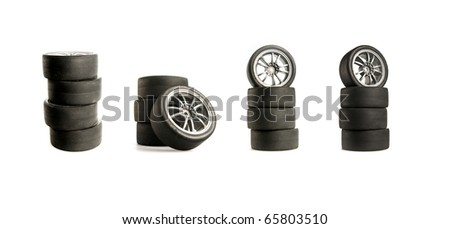 Collage of Four used race tires on white background