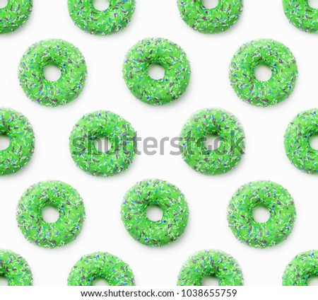 Collage of green doughnuts in glaze on a white background. Lots of donuts mosaic, a tasty fresh green donut drizzled with glaze