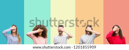 Collage of group of young people over colorful vintage isolated background smiling and laughing with hand on face covering eyes for surprise. Blind concept. #1201855909