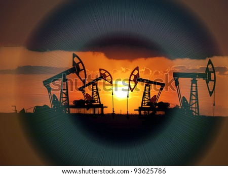 Collage. Oil field at sunset. Superimposed the eye retina