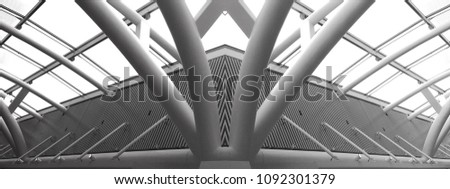 Collage photo of glass and metal structures resembling futuristic building. Abstract black and white modern architecture or construction industry panoramic photo with multiple steel pillars / girders. #1092301379