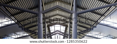 Collage photo of metal structures resembling futuristic building. Abstract modern architecture or construction industry image with steel girders supporting corrugated pitched roof. #1285350622