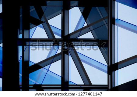 Collage photo of office building fragments in shadows against clear blue sky. Glass wall with metal framework. Structural glazing. Abstract modern architecture background. #1277401147