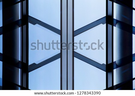Collage photo of office building fragments in shadows against clear blue sky. Glass wall with metal framework. Structural glazing. Abstract modern architecture background. #1278343390