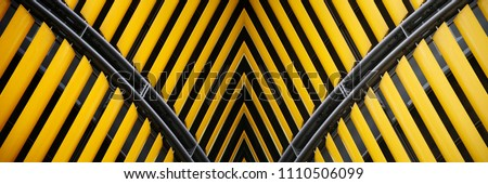 Collage photo on the subject of modern architecture made of yellow shutters / jalousie / louvers. #1110506099