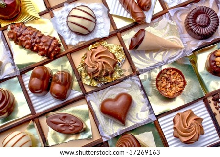 Collage with different chocolates, arranged by myself - stock photo