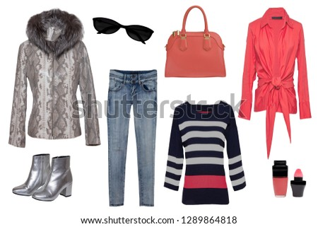 Collage woman clothes. Set of stylish and luxurious trendy women jeans, coat, blouses, sweater and accessories isolated on a white background. Latest fashion trends.