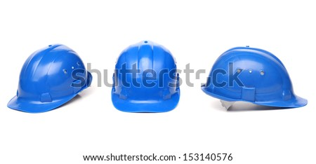 Collagr of blue hard hat isolated on white - stock photo