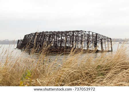 Collapsed metal built structure of a pier in the river #737053972